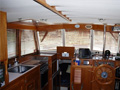 Wood windshield blinds enrich the yacht interior with classic style. The slats can be tilted to control direct sunlight and allow for a view. 80% heat rejection.